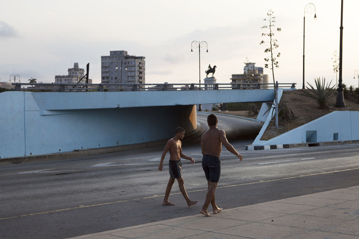 CUBA: Teenage boys on the Malecon at dusk